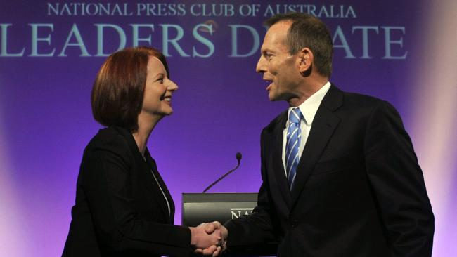 Julia Gillard and conservative opposition leader Tony Abbott shaking hands before the leaders' debate at the National Press Club in Canberra on July 25, 2010. (Pic: AFP Photo / Files / Alan Porritt)