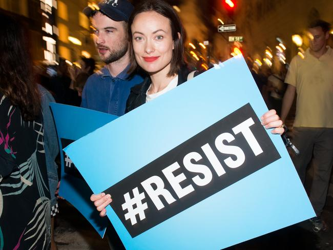 Olivia Wilde joins Michael Moore as he leads his Broadway audience to Trump Tower to protest President Donald Trump. Picture: Noam Galai/Getty Images for DKC/O&M