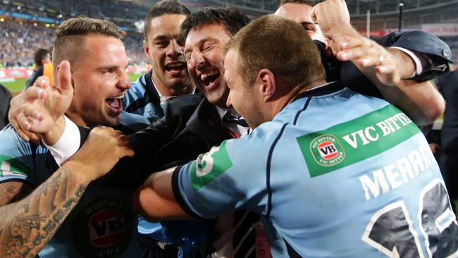 NSW's Jarryd Hayne, Anthony Watmough, Trent Merrin celebrate winning with coach Laurie Daley.