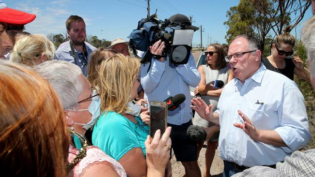 Environment Minister Ian Hunter talks to angry Port Augusta residents after his visit to the Northern Power Station. Picture: Calum Robertson