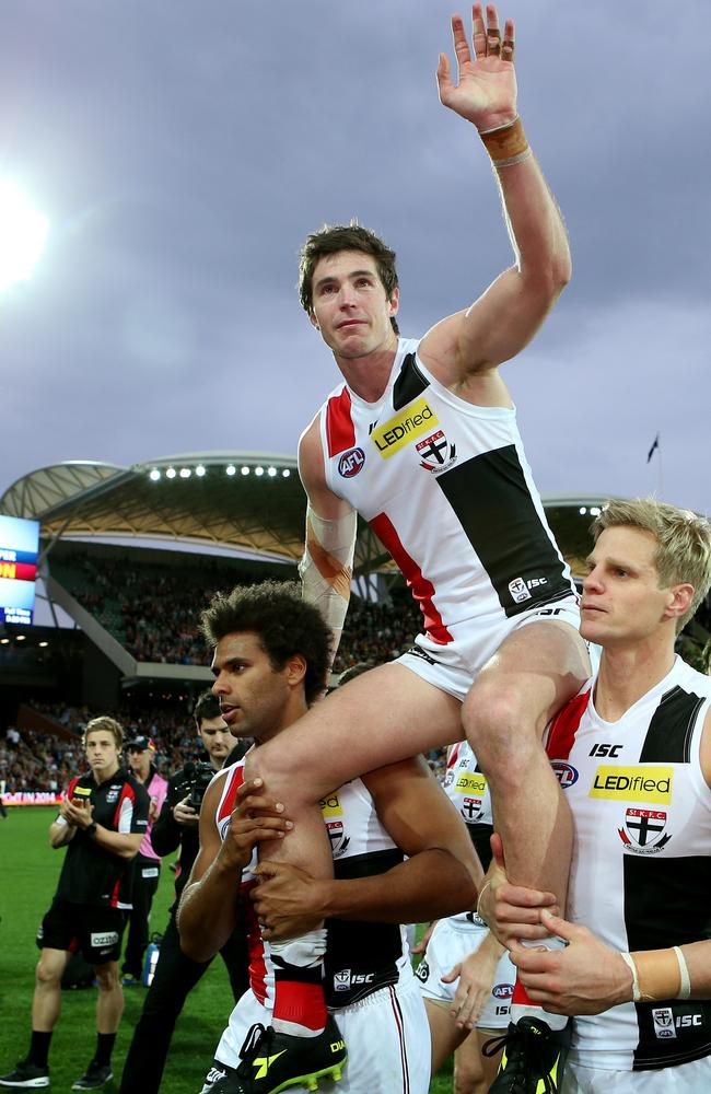 Lenny Hayes chaired off by James Gwilt and Nick Riewoldt. Picture: Sarah Reed