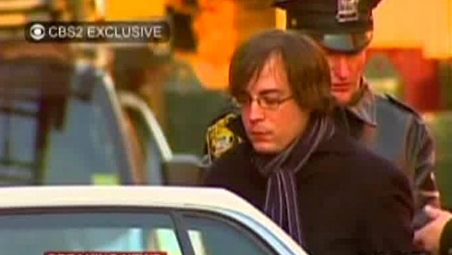 Ryan Lanza, the 24-year-old brother of Sandy Hook Elementary School shooter Adam Lanza, is escorted by police into a cruiser in Hoboken, N.J. Picture: WCBS-TV