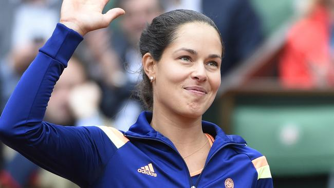 Serbia's Ana Ivanovic celebrates her victory over France's Caroline Garcia at the end of their French tennis Open first round match.