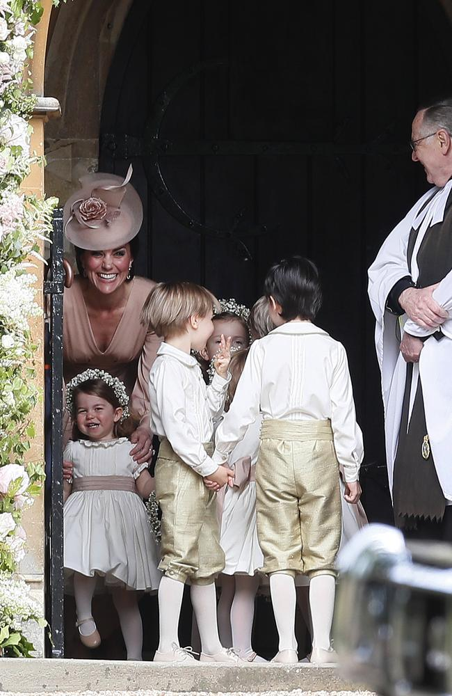 Kate stands with her daughter Princess Charlotte in the church.