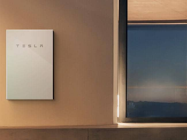 The Tesla Powerwall 2 battery stores electricity collected by solar panels.