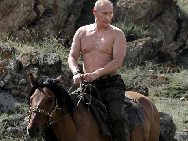 Macho man ... Russian Prime Minister Vladimir Putin rides a horse during his vacation outside the town of Kyzyl in southern Siberia. Picture: AFP