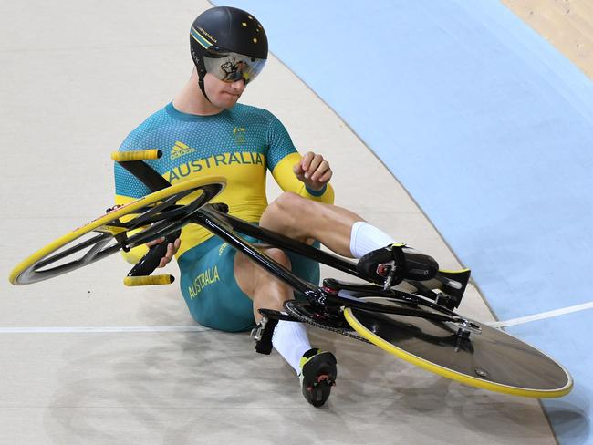 Matthew Glaetzer crashes down to earth in the men's keirin finals. Picture: Greg Baker