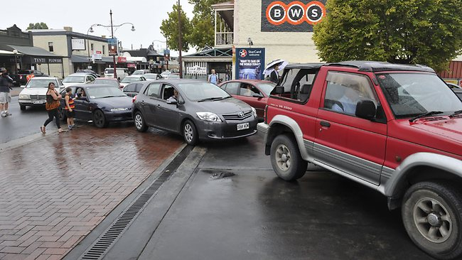 Cars line up to take advantage of the 88.8c per litre price at Caltex on O'Connell St. Picture: Campbell Brodie
