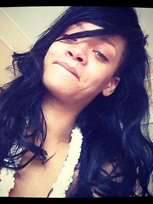 Rihanna takes selfies for her fans on Instagram.