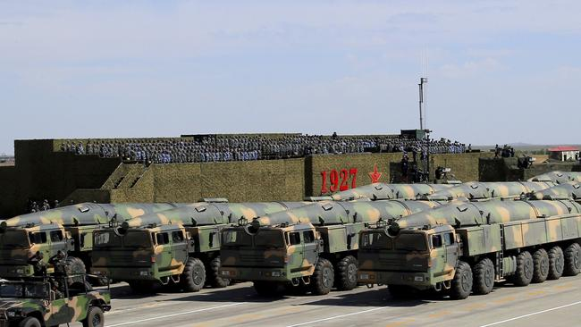 Chinese military vehicles carrying missiles for both nuclear and conventional strikes are driven past the VIP stage. Picture: Zha Chunming/Xinhua via AP