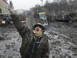 A pro-European Union activist shouts slogans during clashes with police in central Kiev. (AP Photo/Sergei Chuzavkov, File)