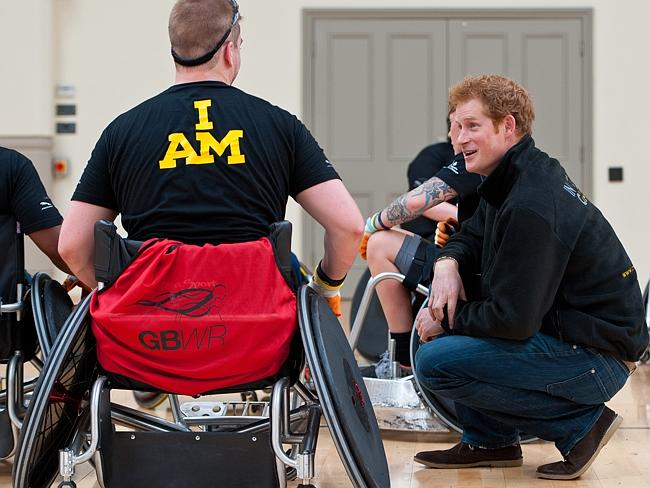 Prince Harry meets veteran Charlie Walker at the launch of the Invictus Games selection process in England.