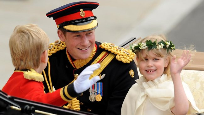 Best man Prince Harry and his young assistants wave to the crowds. Picture: AFP
