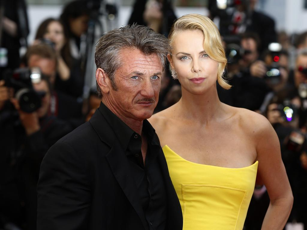 """Charlize Theron and partner Sean Penn pose as they arrive for the screening of the film """"Mad Max : Fury Road"""" during the 2015 Cannes Film Festival. Picture: AFP"""
