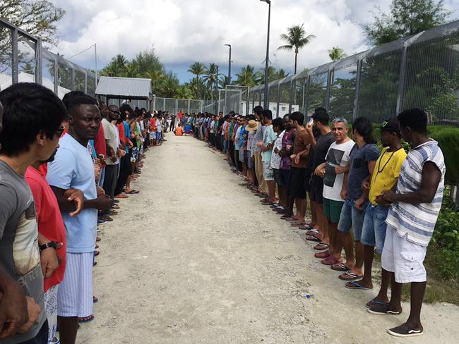 Refugees at Manus Island detention centre link hands in solidarity ahead of the centre's closure. Picture: AAP Image