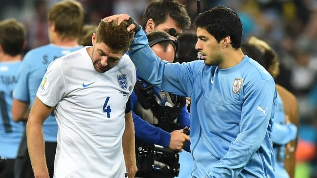 England's midfielder and captain Steven Gerrard is consoled by Luis Suarez.