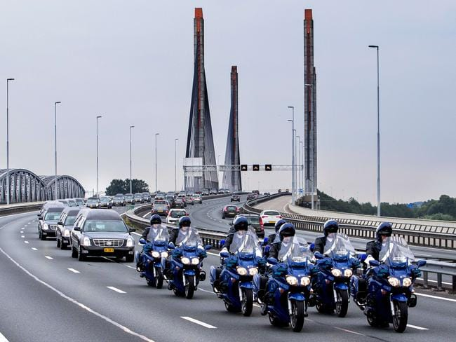 Ceremonial ... a column of hearses proceeds from the Eindhoven air base to Hilversum. Picture: Vincent Janninck
