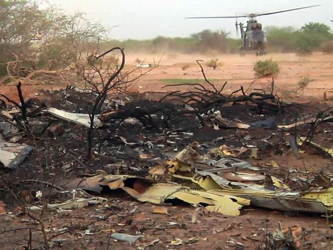 Searching for answers ... a helicopter at the site of the plane crash in Mali.