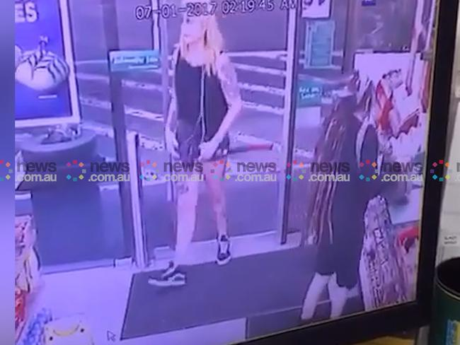 2.19am, January 7: A woman strolls into Enmore 7-Eleven carrying a long-handled axe in her hand. Picture: news.com.au