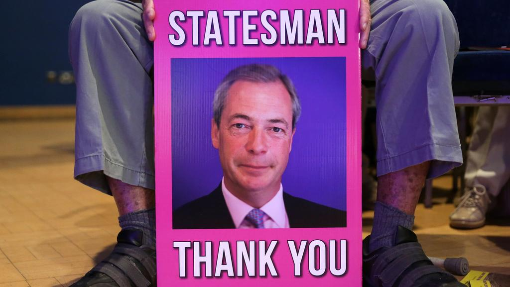 A UKIP activist holds a placard of now interim anti-EU UK Independence Party (UKIP) leader Nigel Farage at the party's conference in Bournemouth, on the southern coast of England last month. Picture: Daniel Leal-Olivas/AFP