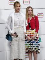 PARIS FASHION WEEK 2014: Actress Melanie Griffith and daughter Stella Banderas pose upon arrival to attend the Chanel show. Picture: AFP