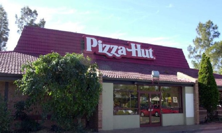 The iconic red-roofed Pizza Hut restaurant.