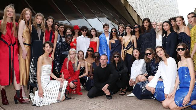 Designer Dion Lee poses for a photo with models following the Mercedes-Benz Presents Dion Lee show at Mercedes-Benz Fashion Week Resort 18 Collections at the Sydney Opera House. Picture: Cole Bennetts