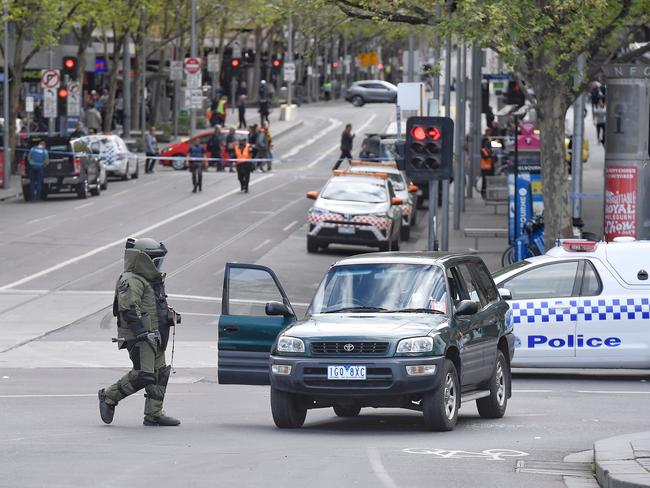 Police and bomb squad with sniffer dogs check over a Rav 4 on corner of Flinders and Swanston streets, Melbourne CBD. Picture: Jason Edwards
