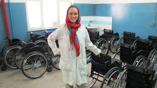 Martina Lukin standing among the wheelchairs produced at the Kabul clinic. This is another important aspect of the work that is done there. They produce and supply wheelchairs to all of Afghanistan. Picture: Australian Red Cross