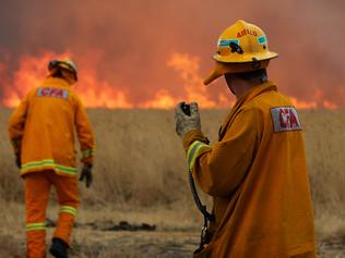 CFA firefighters working to control a bushfire that started near Donnybrook on the fringe of Melbourne and burned towards the suburb of Epping.