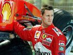 Schumacher standing next wreckage of his Ferrari at the 2001 Australian Grand Prix.