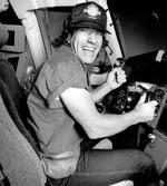 <p>November 11, 1991: Sydney, NSW. Brian Johnson, lead singer of the rock band 'AC/DC', tries his hand in a Qantas flight simulator in Sydney, which ends in a mid-air collision with a jumbo jet. Pic. Bob Barker</p>