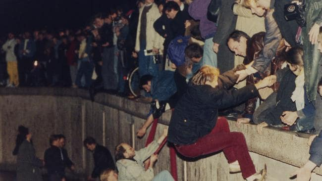 The bringing down of the Berlin Wall in November 1989 signalled the end of the Cold War - and the threat of nuclear annihilation which pervaded the decade. AP Photo/Jockel Finck