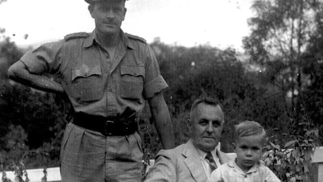 Ray's grandson Brian White, now Joint Chairman and third generation leader of the Ray White Group can be seen sitting on Ray White's knee as a child, with his father and Ray's son Alan White standing.