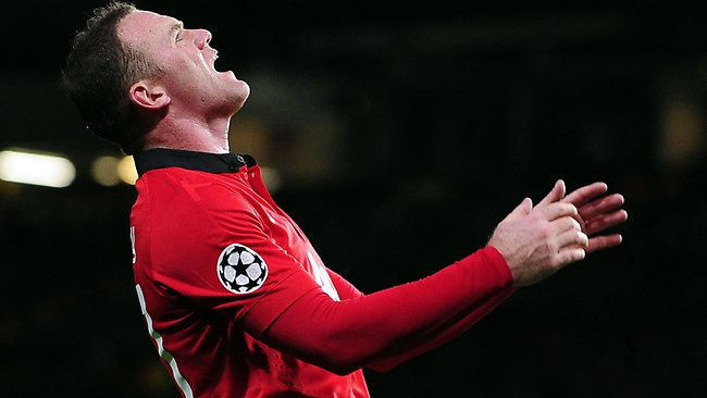 Manchester United's English striker Wayne Rooney reacts to a missed chance during the UEFA Champions League Group A football match between Manchester United and Real Sociedad.