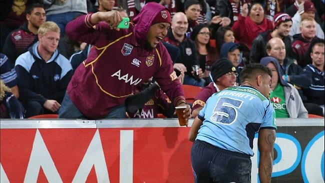 NSW winger Nathan Merritt cops it from a Queensland fan during State of Origin II.