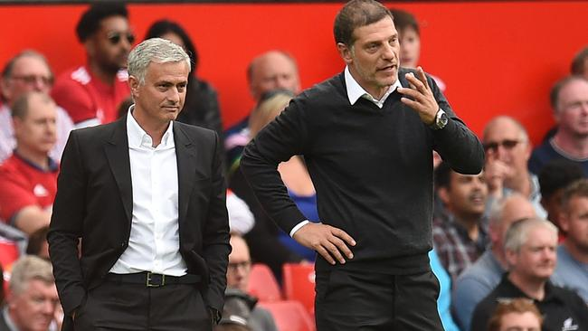 Manchester United's Portuguese manager Jose Mourinho (L) speaks with West Ham United's Croatian manager Slaven Bilic (R)