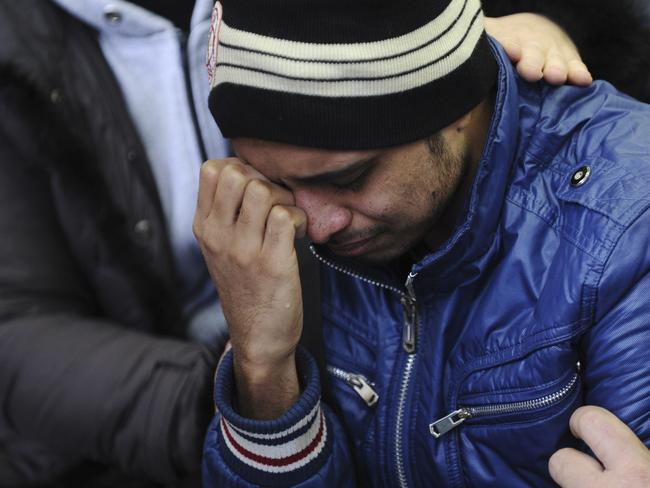 Grief ... A relative of the plane crash victim sobs as he is comforted by other relatives at the Rostov-on-Don airport, about 950 kilometres south of Moscow. Picture: AP