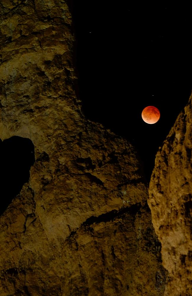 The moon appeared red-orange because of the sunsets and sunrises shimmering from Earth, earning it the name blood moon