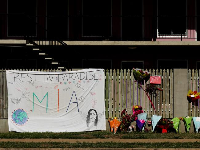 Flowers and memorial at scene of Home Hill Backpackers. Picture: Mark Calleja