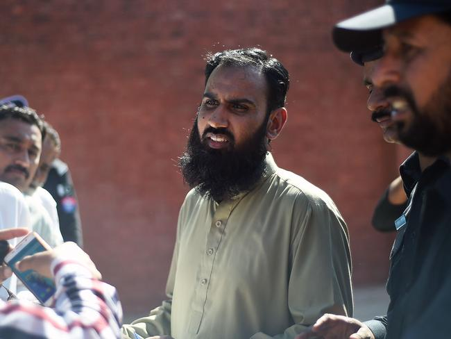 A Pakistani anti-terrorism court official announces the verdict for ex-prime minister Benazir Bhutto's murder trial at Adyala Prison in Rawalpindi on Friday. Picture: Farooq Naeem/AFP