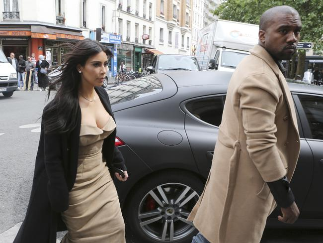 Kim Kardashian and U.S. rap singer Kanye West arrive at a luxury shop in Paris.