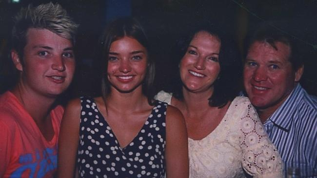 Sunburnt ... Miranda Kerr with her family during happier times.