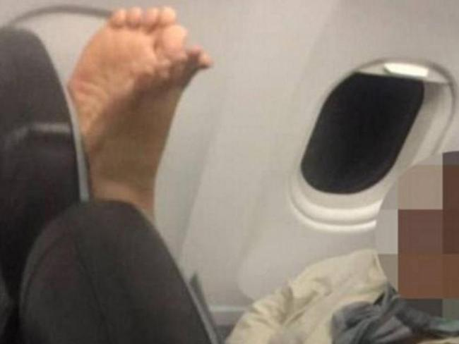 The woman captured a photo of the passenger and their offending feet.