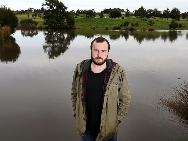 Brad Guy landed in a lake at the Croydon Golf Club. Picture: Ian Currie