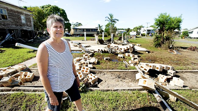 Denise Ryan at her mother's property in Thornhill St, North Bundaberg, where flood waters washed the house off the stumps. Picture: Mark Calleja