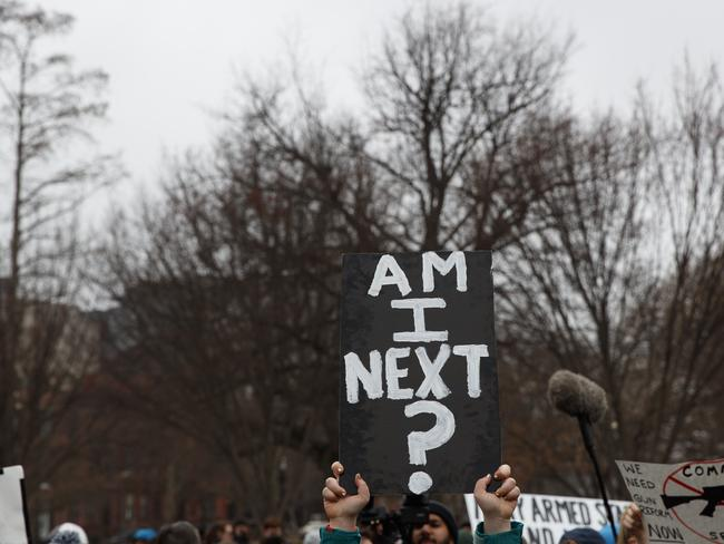Demonstrators hold signs during a protest in favour of gun control reform in front of the White House. Picture: AP/Evan Vucci