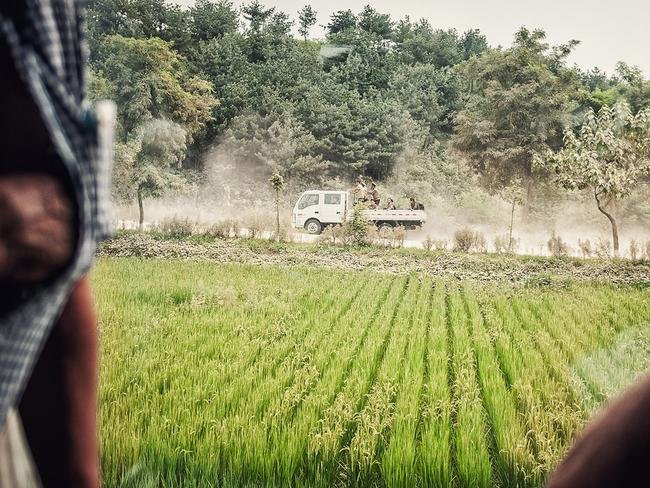 North Korean soldiers, seen through a train window. Picture: Michal Huniewicz /Exclusivepix Media