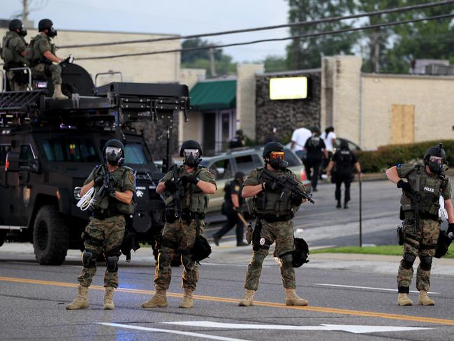 Police protection ... Authorities in Ferguson used tear gas and rubber bullets to try to disperse a large crowd that had gathered at the site of a burnt-out convenience store damaged earlier. Source: AP