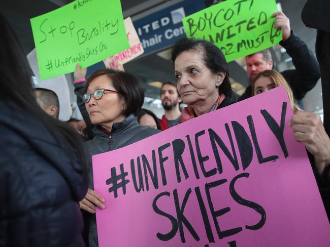 Demonstrators protest outside the United Airlines terminal at O'Hare International Airport after a passenger dragged from his seat and bloodied by airport police. Picture: Scott Olson/Getty Images/AFP